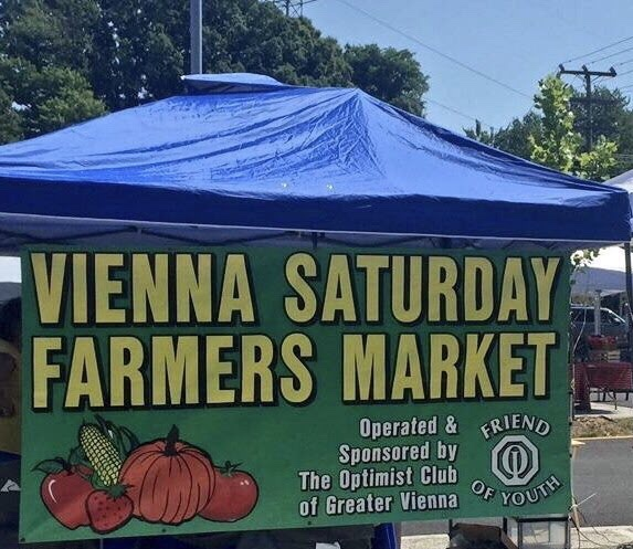blue canopy sign Vienna Saturday Farmers Market yellow letters on Green with produce