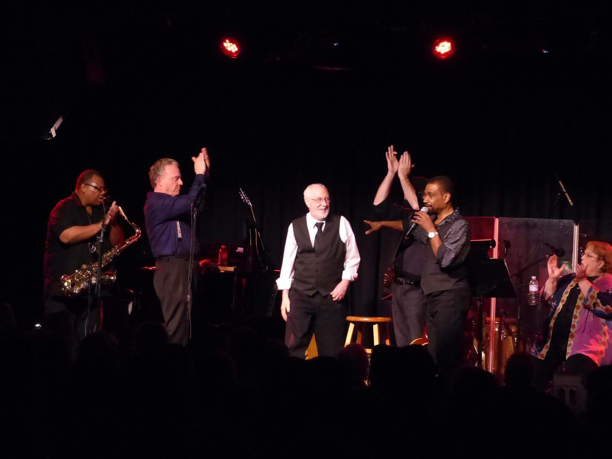Arthur Lisi at the Birchmere with Cleve Francis musicians onstage clapping