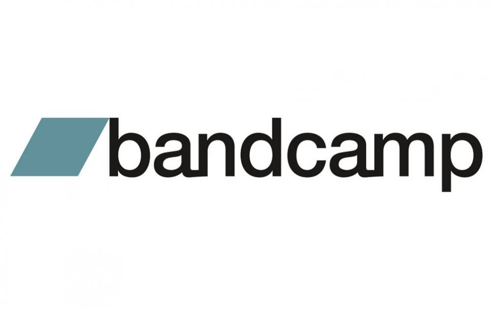 Light blue rectangle band camp logo black lettering